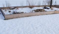 Gehege bedeckt mit Schnee